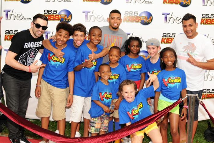 DJ EV and KISS FM Cleveland KCrew with Joe Haden on the 96.5 Red Carpet, Event Photography © Amy Weiser, Photographer