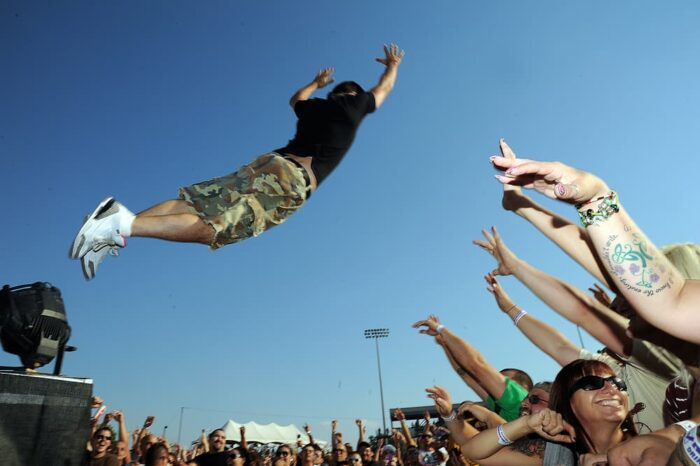 DJ EV Jumping into the Crowd at RoverFest © Amy Weiser, Photographer