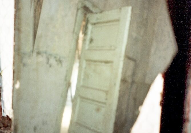 Mirrored Door in an Abandoned Building © Amy Weiser, Photographer