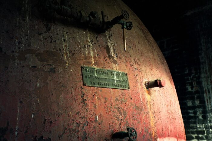 Rusted Water Tank in an Abandoned Building © Amy Weiser, Photographer
